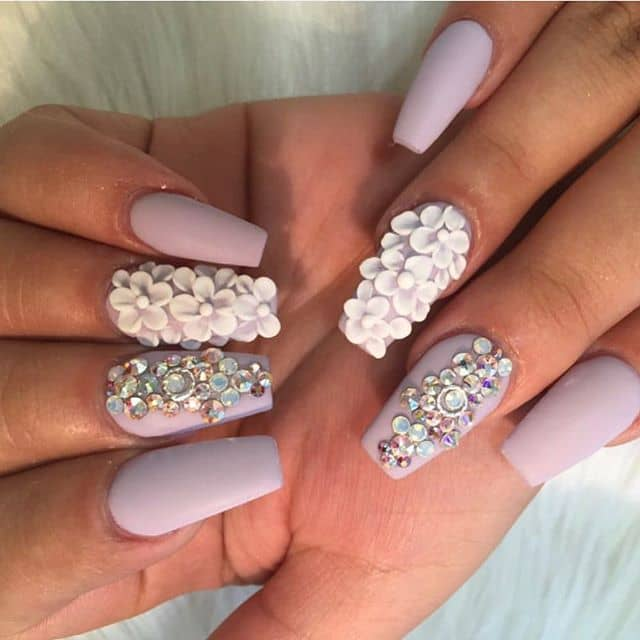 Pastel Nails with Gems and Floral Accents