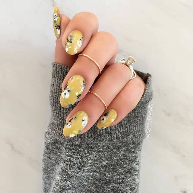 Yellow Nails with a Cute Floral Design