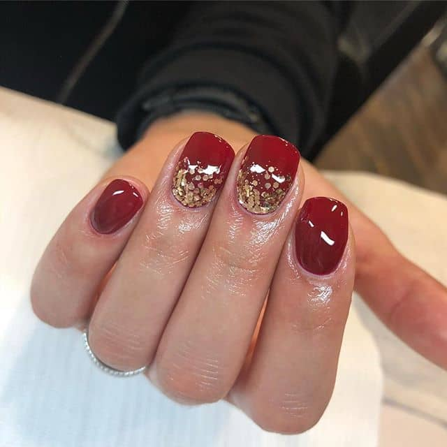Elegant Glossy Red and Gold Confetti Nails