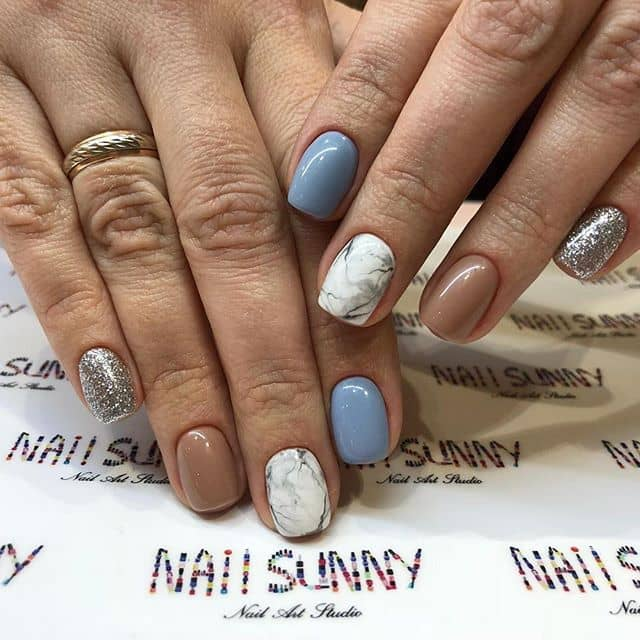 Elegant Marble Nail Art with Blue and Silver Accents