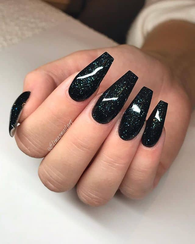 Black Nails with a Cosmic Sparkle