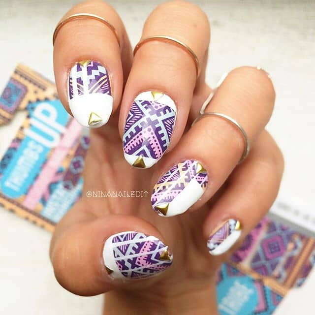 Tribal-Inspired White, Gold, and Purple Nails