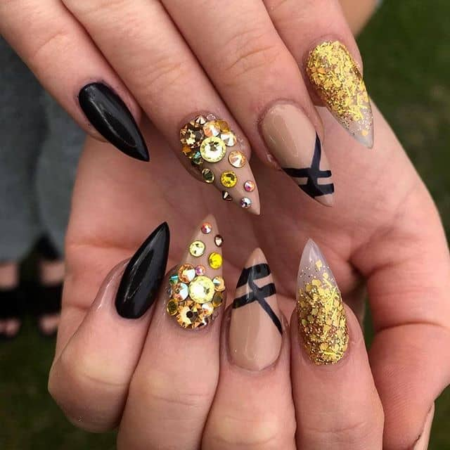 Black, Gold, and Bejeweled Talon Nails