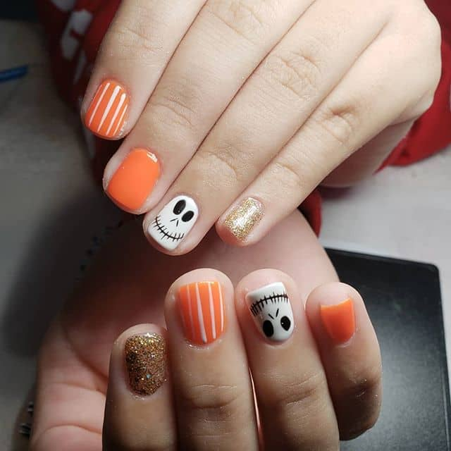 Skull, Stripes, and Sparkles Halloween Nails