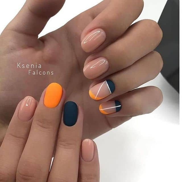 Nude Nails with Orange and Black Accents