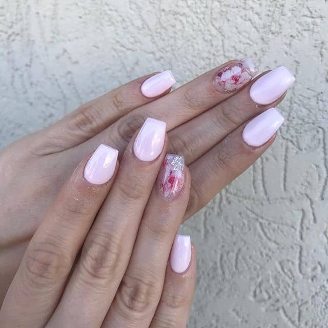 Pale Pink Nails with a Floral Accent