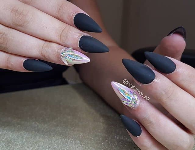 Ink Black Stiletto Nails with Lotus Flower Embellishment