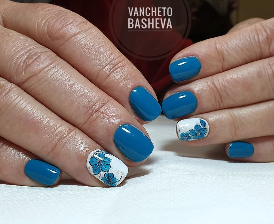Vintage Blue Mani with Flowery White Accent Nails