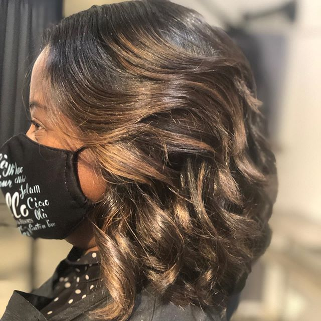 Curly Bob with Golden Highlights