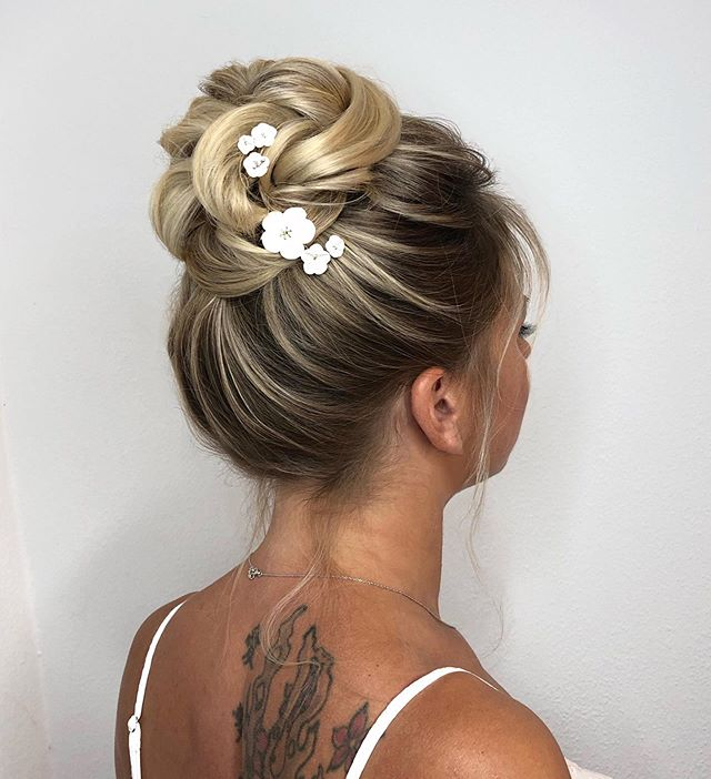 This Twisted Floral Boho Bun is one of the Best Bridal Hairstyle Ideas