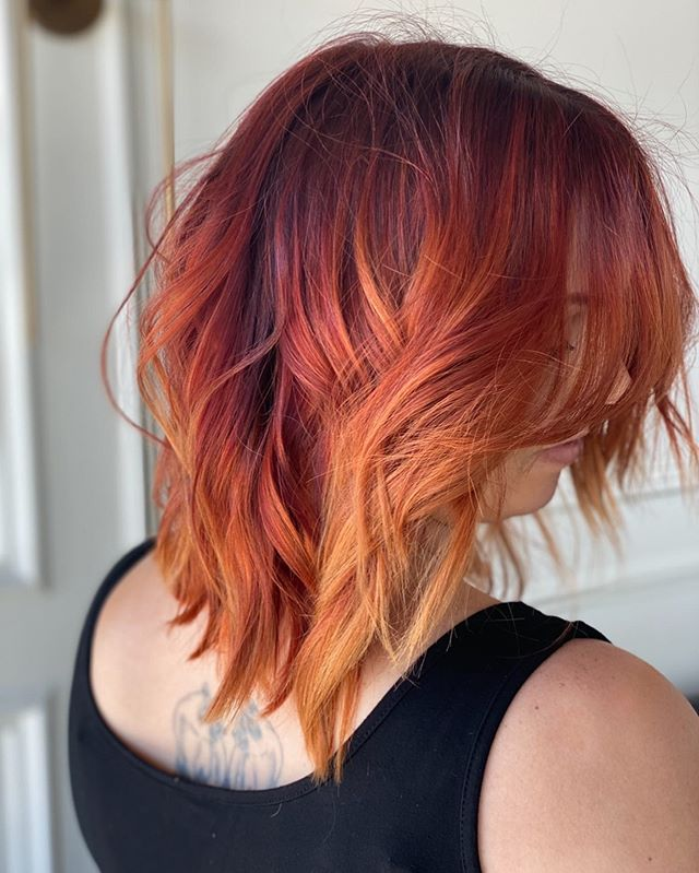 Bright Red and Orange Ombre on Wavy Mid-Length Hair