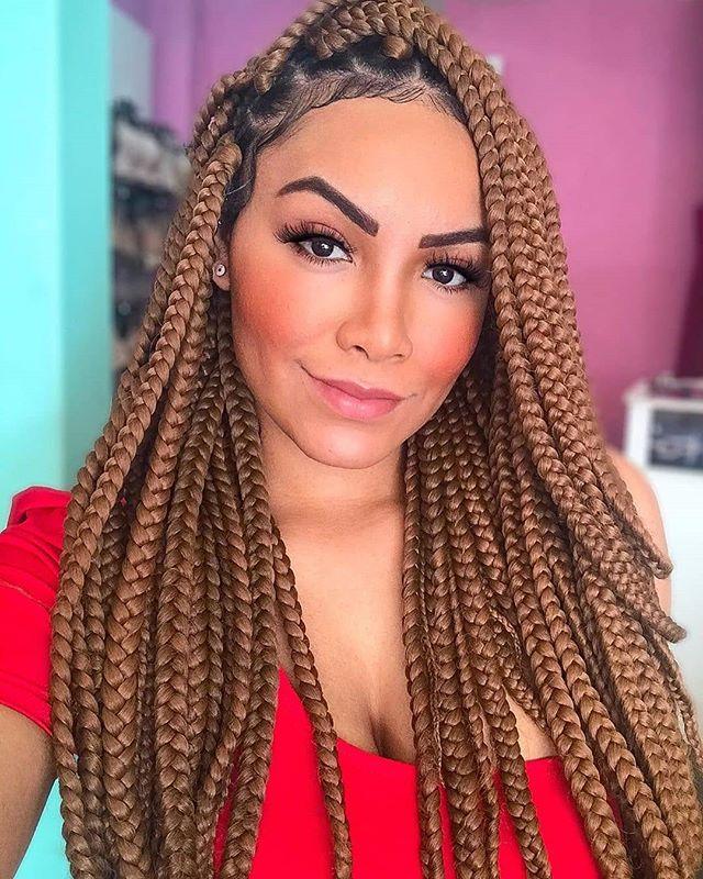 Golden brown braids and gelled edges