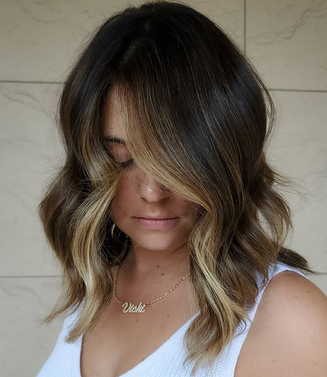 Flirty Over-the-Face Waves with Blonde Highlights