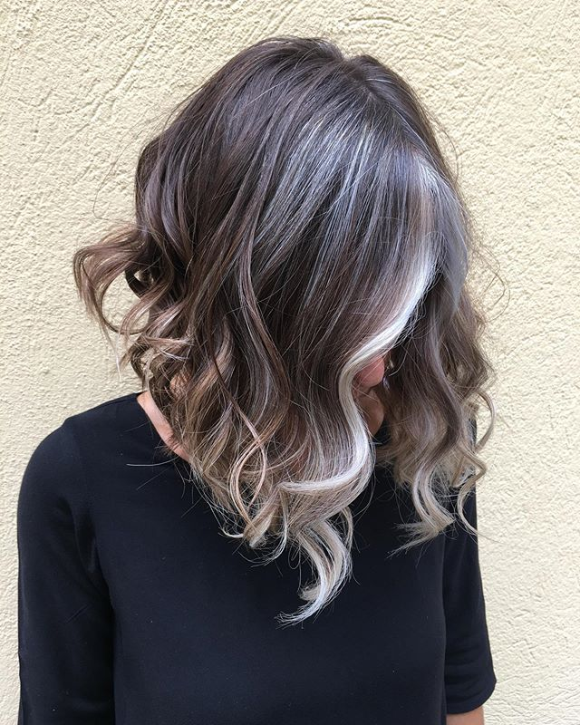 Wavy Angled Bob with Grey Peekaboo Highlights