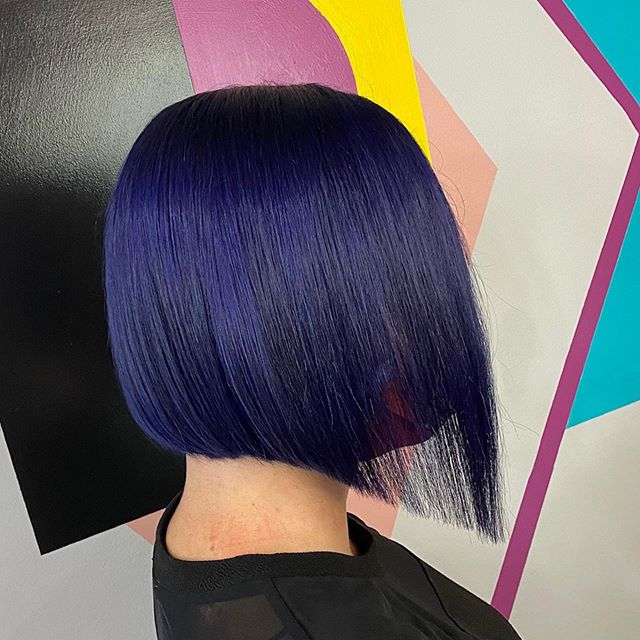 Curved Over-the-Shoulder Asymmetrical Look with Purple Tones