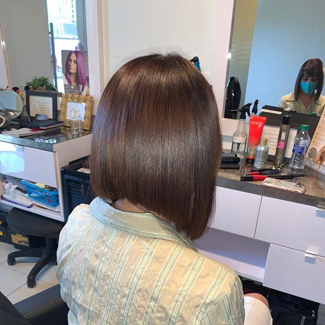 Sleek and Shiny Over-the-Shoulder Asymmetrical Bob