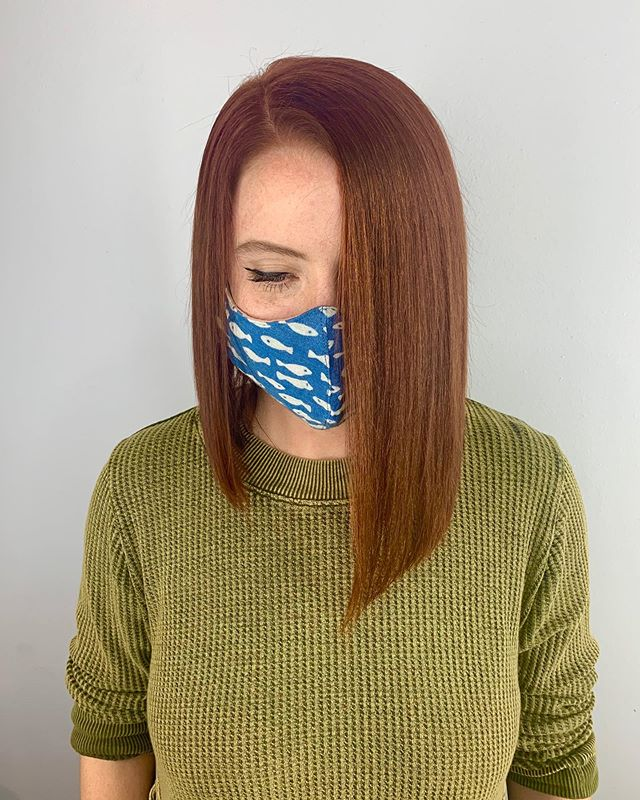 Asymmetrical Copper Hairdo with Plunging Side Part