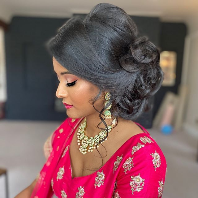 Chic Volume and Pinned Curls for Indian Brides
