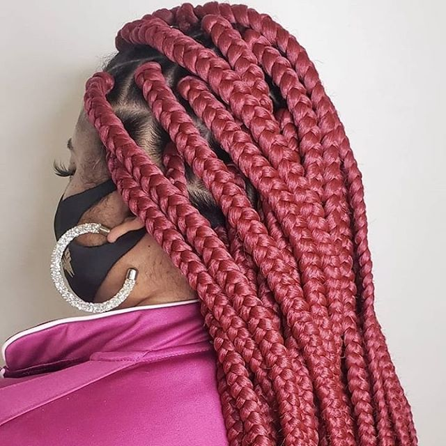 Huge and long red braids