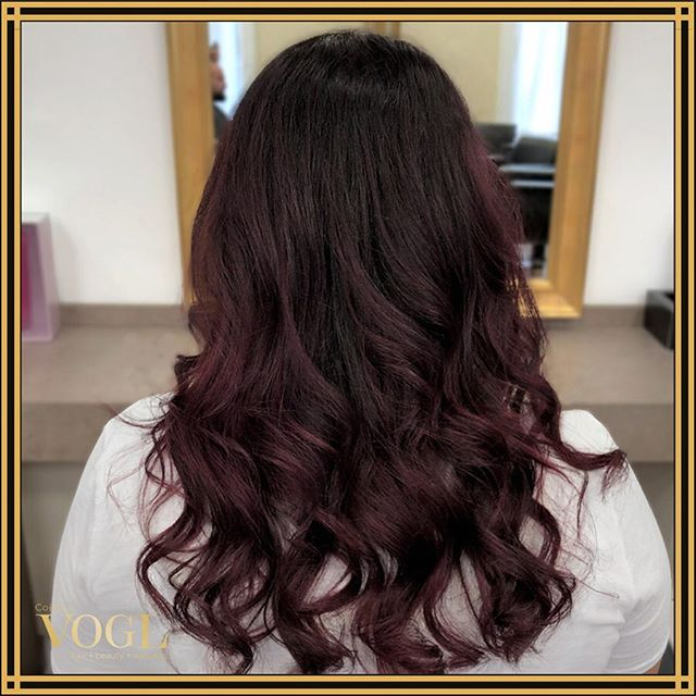 Captivating Magenta Highlights On Dark Hair