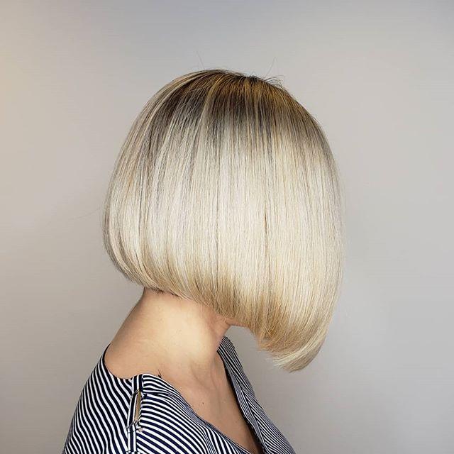 Blonde Over-the-Shoulder Asymmetrical Cut