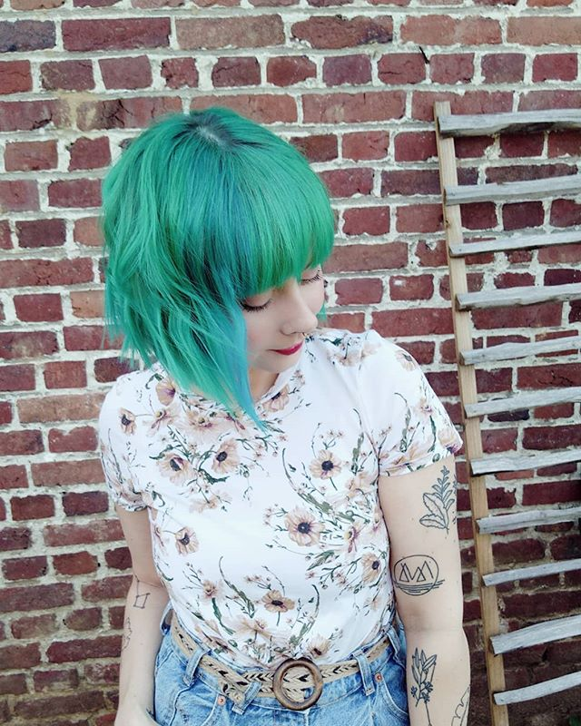 Asymmetrical Cut with Bangs and Blue-Green Color