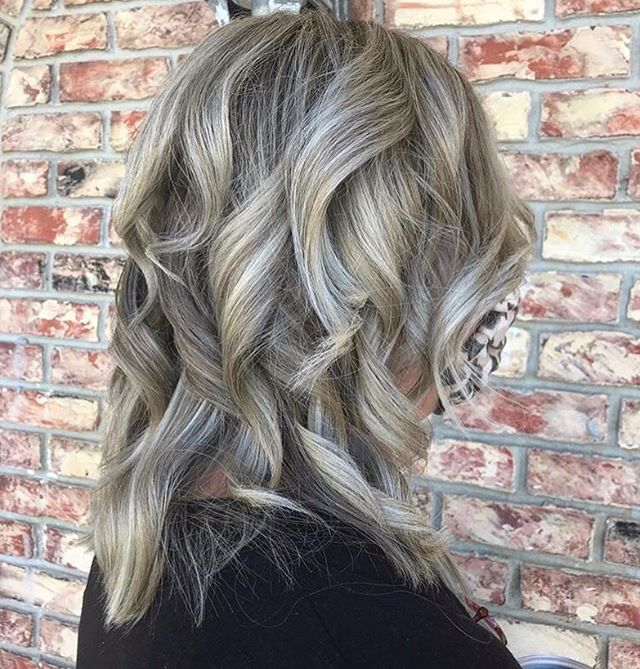 Ash-Blonde Piecey Curls with Heavy Layers