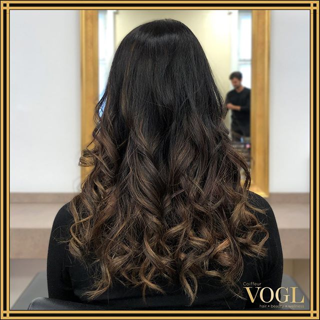 Caramel Highlights Over Soft Dark Curls