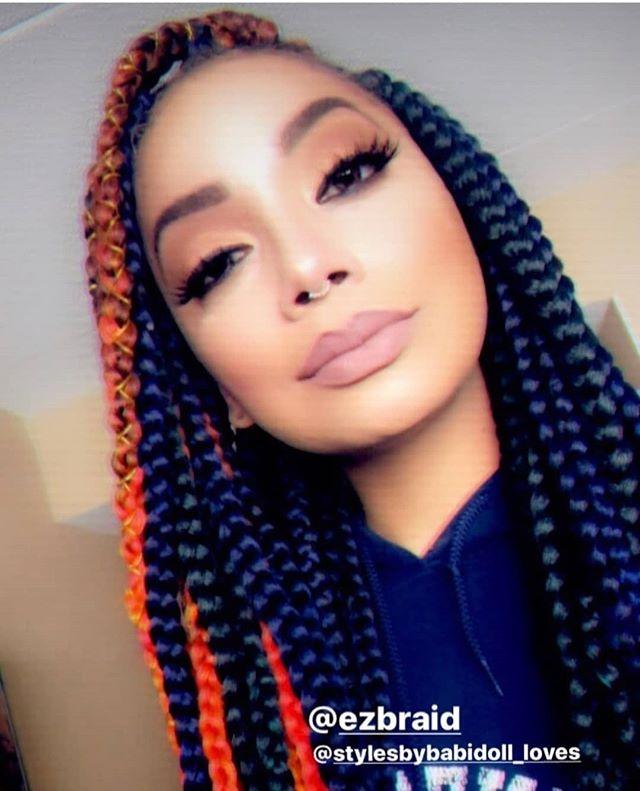 Long braids, orange streaks, and deep part