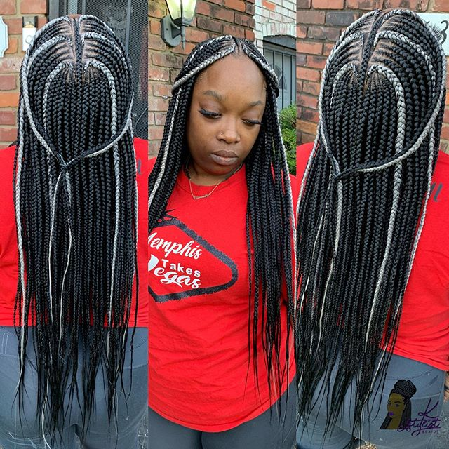 A Mix Of Grey And Black Long Braids