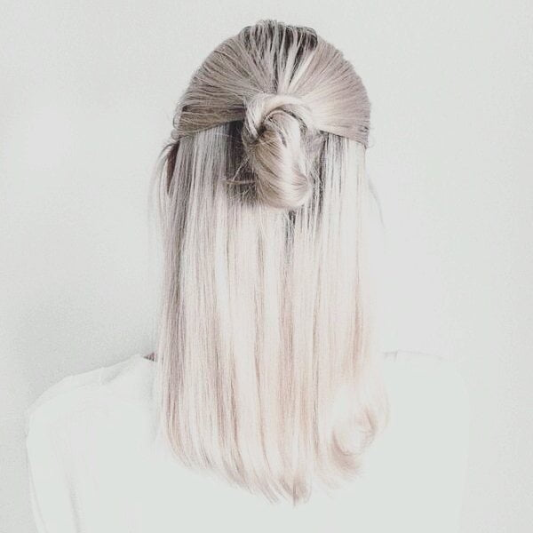 Icy Blonde Mid-Length Hair with Half Bun Updo