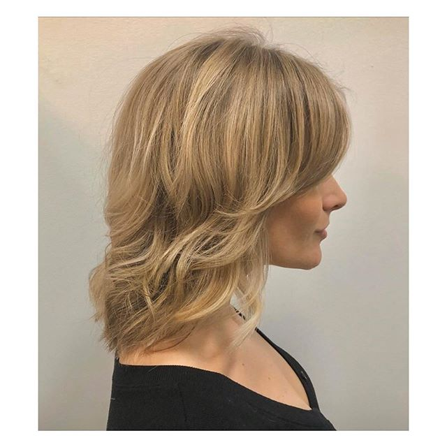 Stylish Feathered Hairstyle For Short Hair