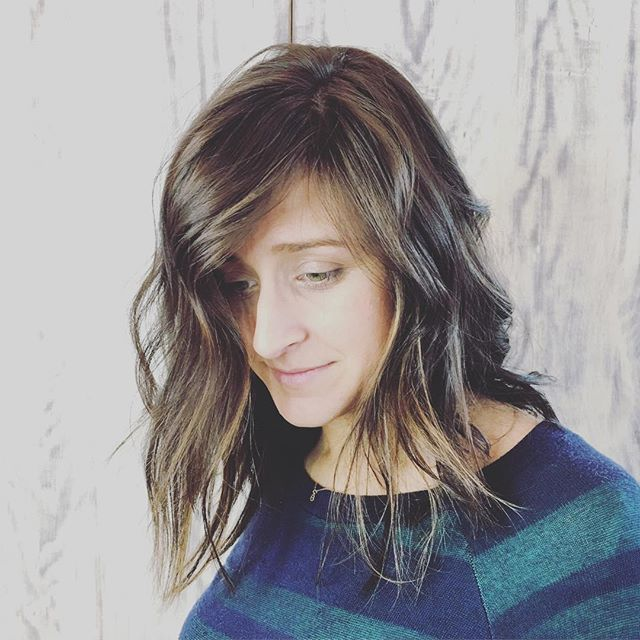 Shaggy and Messy Feathered Layers on Medium-Length Hair