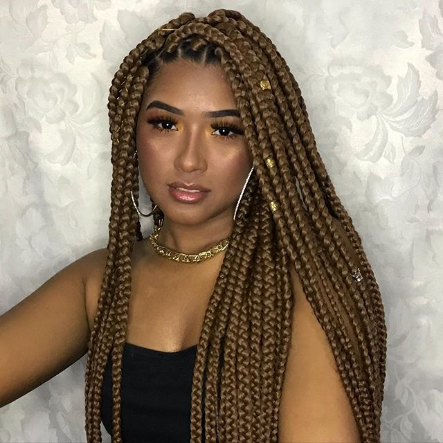 Elegantly done braids with golden beads