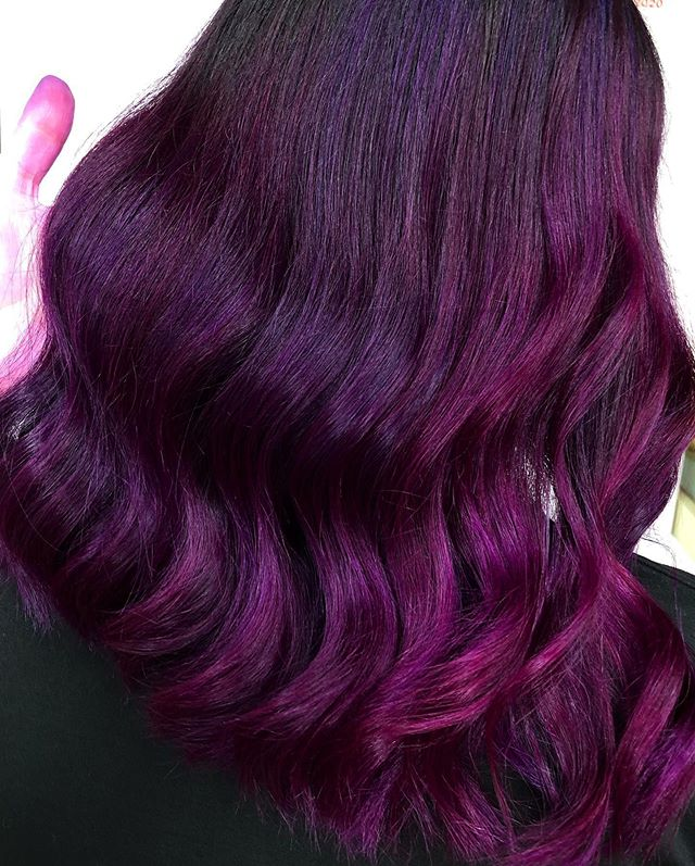 Flashy Mauve Thick Curled Hairstyle