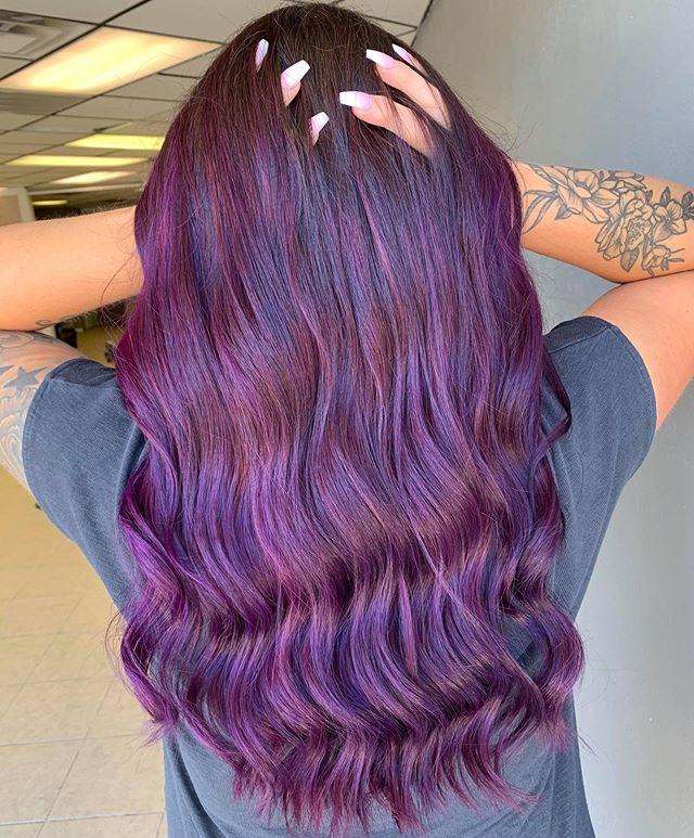 Tumbling Curls Highlighted With the Best Dark Purple Hair Color Ideas