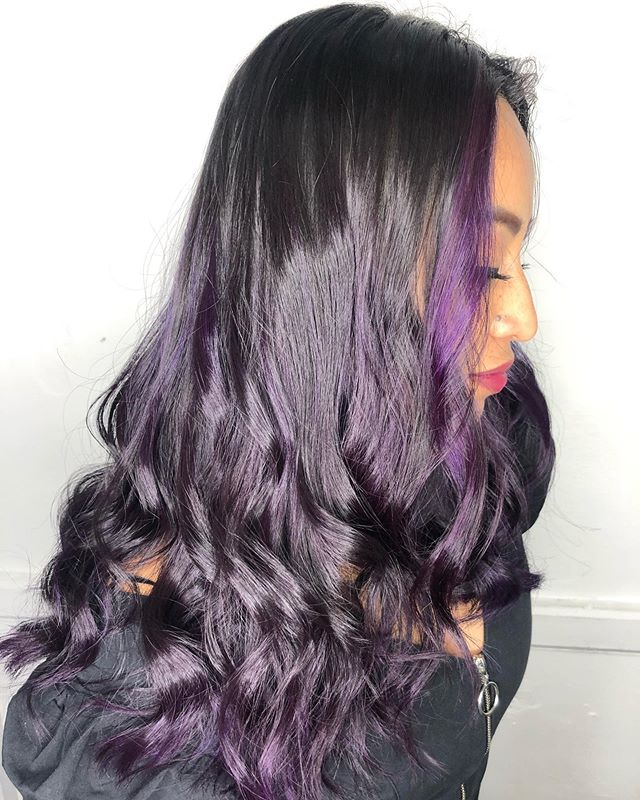 Raven-Colored Curls With Flashy Purple Bangs