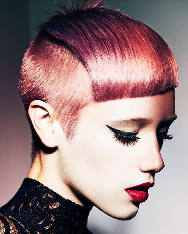 Edgy Berry-Colored Pixie with Bangs and Fade