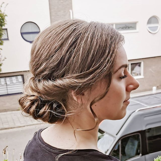 Delicate Tucked Bun With Loose Curls