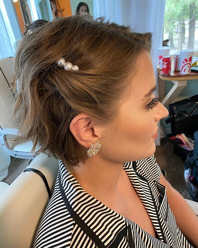 Pearls Tucked into Chic Wavy Updo