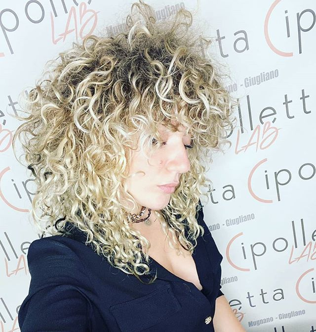 Modern Mullet with Bleached Curls