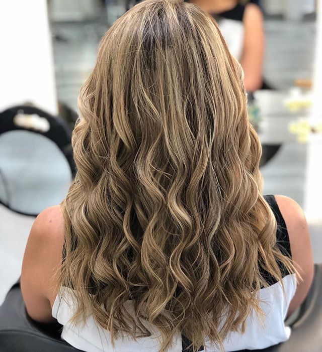 Cascading Curls with Ashy Blond Highlights