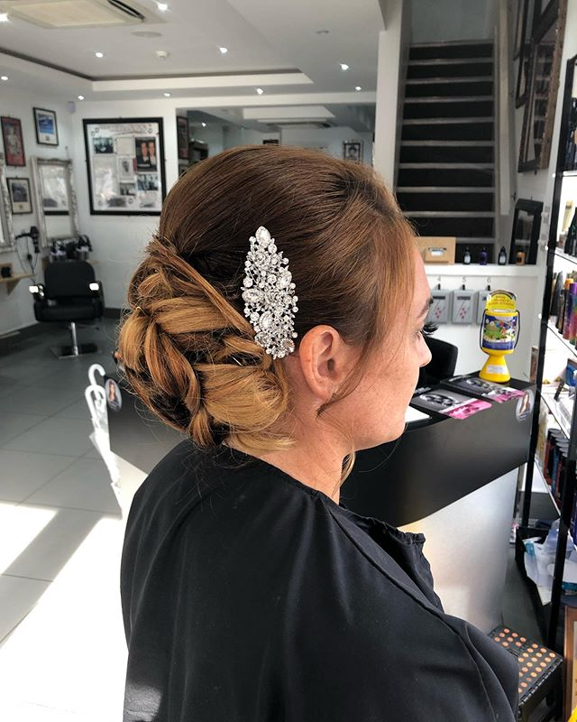 Urbane Updo For A Glossy Look
