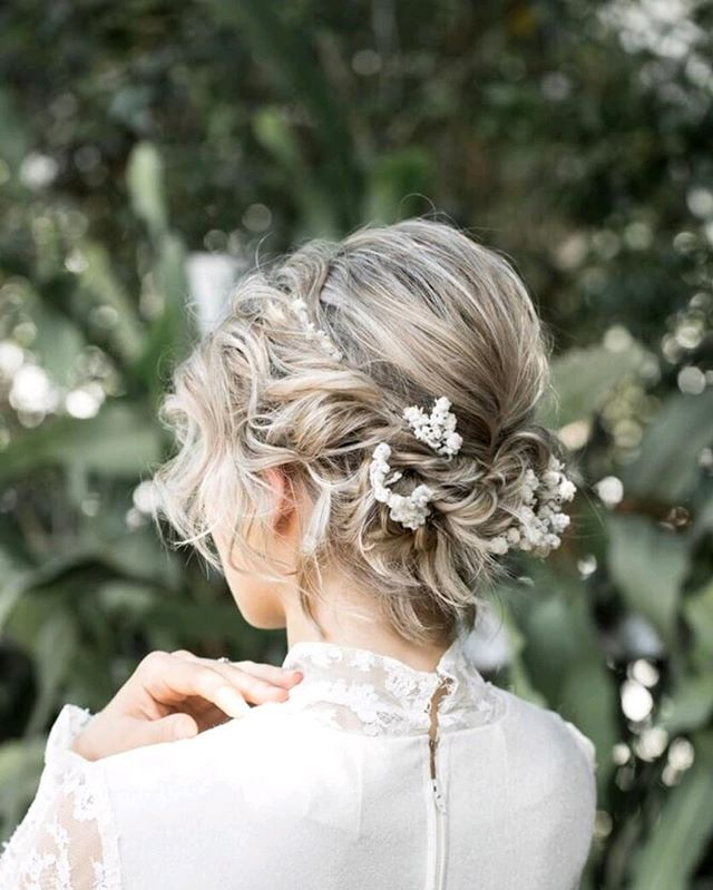 Flowers Braided Into Natural Wavy Bun