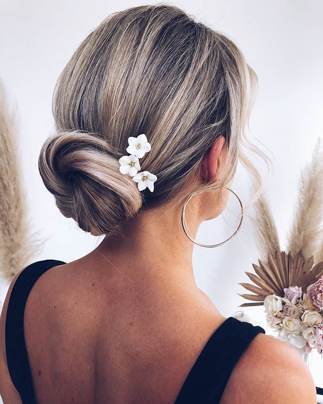 Simple Low Bun With A Tasteful Accessory
