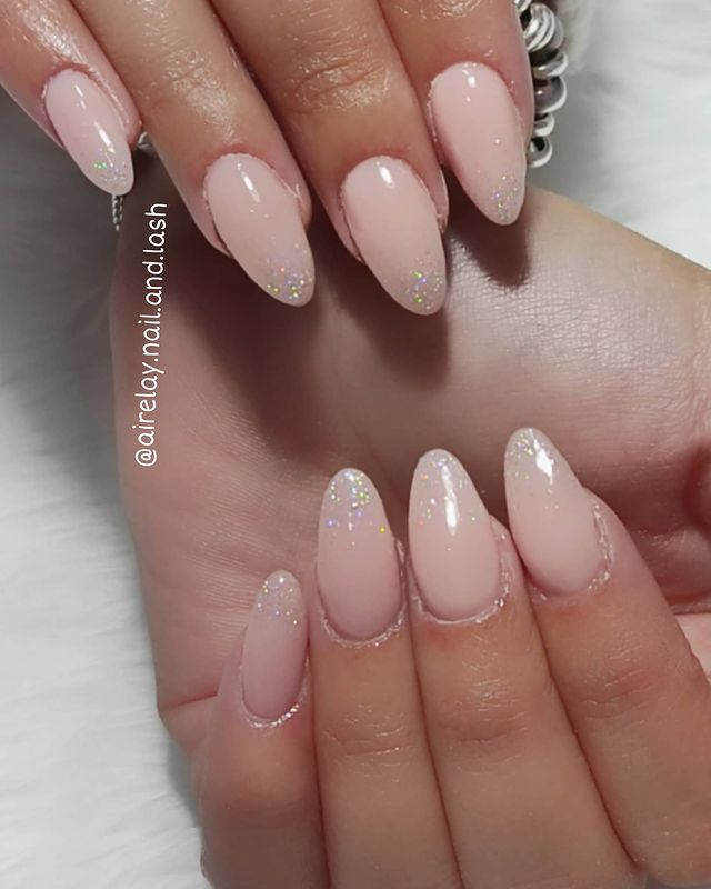 Pale Pink Almond Nails with Shimmery Embellishments