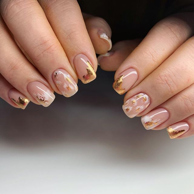 Short, Nude Nails with White and Gold Brush Strokes