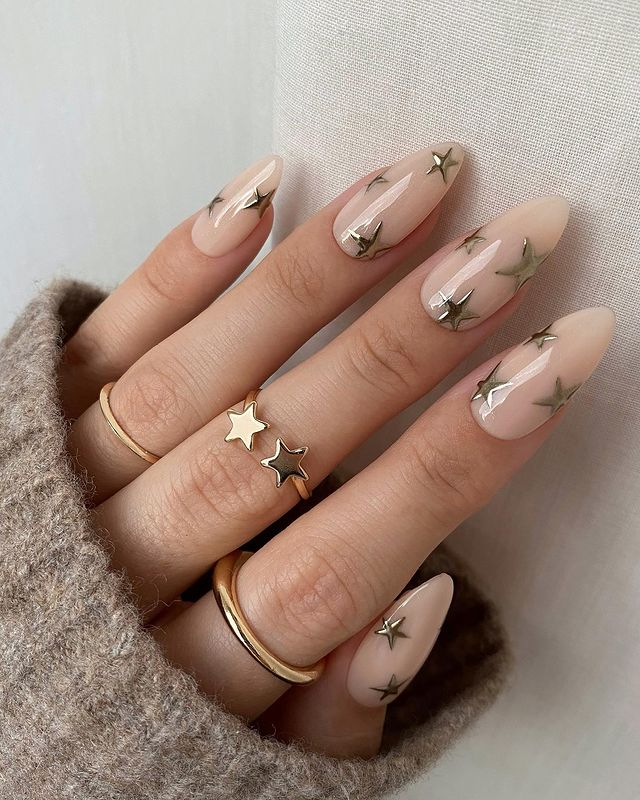 Pale Pink Stiletto Nails with Soft Gold Star Decals