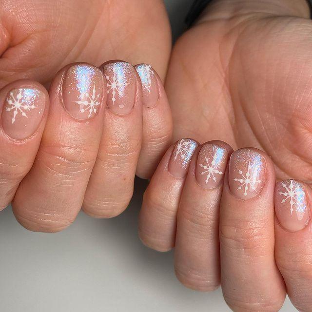 Short Nude Nails with Shimmer and Snowflakes