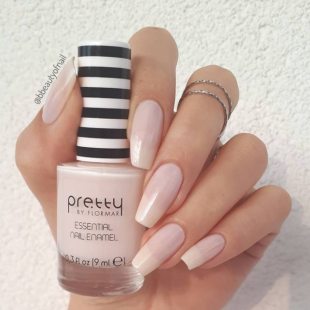 Charming Pastel Pink Nails with Large White Stars